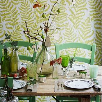 Country-Christmas-dining-room-with-green-fern-wallpaper-green-chairs-and-Christmas-decorations--Country-Homes-and-Interiors--Housetohome.co.uk